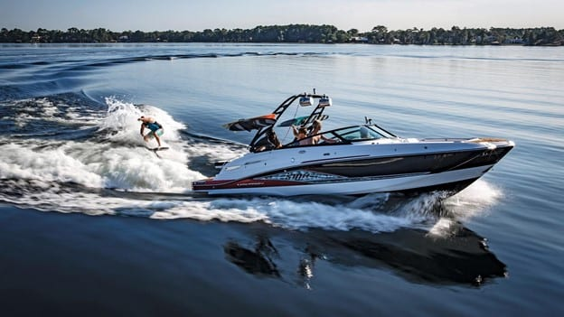 A wakeboarder behind a 2020 Bowrider Boat. You can find bowrider boats for sale in Australia at Boat Deals.